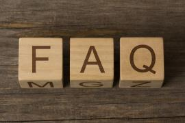 text FAQ on a wooden cubes