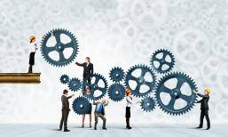 Conceptual image of businessteam working cohesively.